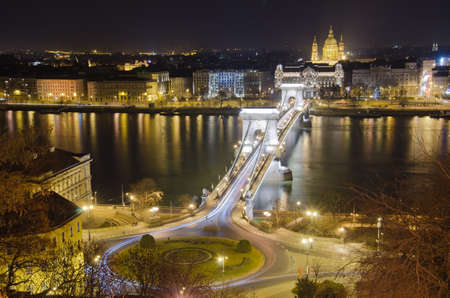 View of Chain Bridge and St. Stephens Basilica at night.Budapest, Hungary photo