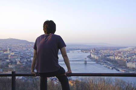 Man enjoying Budapest from gellert hill.