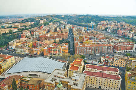 known: Aerial view of Vatican city, as seen from the top of the Vatican