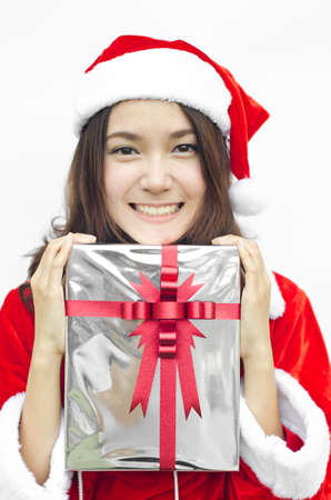 Portrait of young beautiful woman in santa claus hat with grey christmas gift box with red ribbons. photo