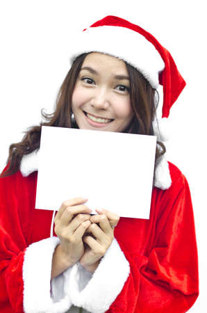 Girl in Santa holding banner. Cute funny image closeup of christmas woman with copyspace. Isolated on white background. photo