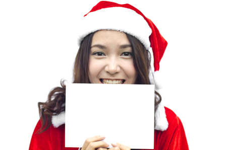 Girl in Santa holding banner. Cute funny photo closeup of christmas woman with copyspace. Isolated on white background. Stock Photo - 15921823