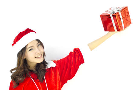 Portrait of young beautiful woman in santa claus hat with red christmas gift box with grey ribbons. Stock Photo - 15921840
