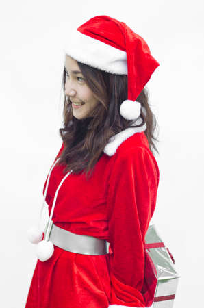 santa claus girl with gift box in hands over white, isolated photo