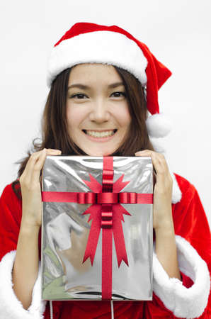 Portrait of young beautiful woman in santa claus hat with grey christmas gift box with red ribbons. Stock Photo - 16252627