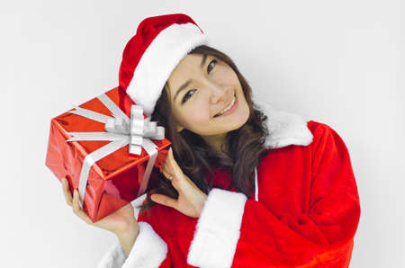 Portrait of young beautiful woman in santa claus hat with red christmas gift box with grey ribbons. Stock Photo - 16252623