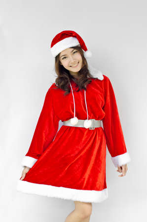 Beautiful young santa clause woman in christmas clothes smiling . isolated on white background photo