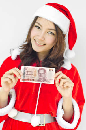 christmas woman wearing santa hat and holding money - isolated on white background