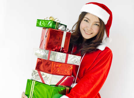 Portrait of young beautiful woman in santa claus hat with christmas gift boxes with ribbons. photo