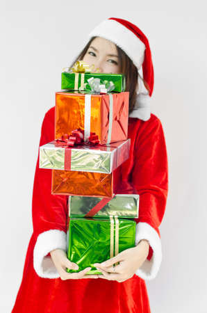Portrait of young beautiful woman in santa claus hat with christmas gift boxes with ribbons. Stock Photo - 16252586