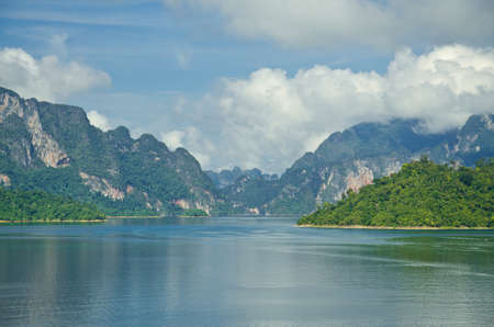 Beautiful mountain surrounded by water, Natural attractions in Ratchapapha dam at Surat Thani province, Guilin of Thailand. photo