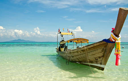 Beautiful image Longtail boat on the sea tropical beach. Andaman Sea,Krabi, Thailand photo