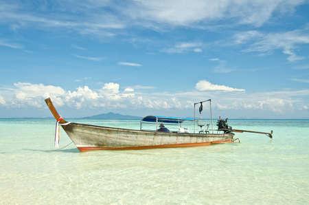 Beautiful image Longtail boat on the sea tropical beach. Andaman Sea,Krabi, Thailand photo
