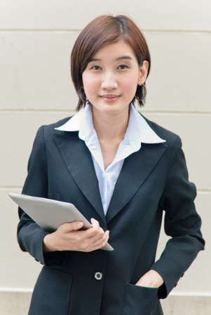 Asian business woman using tablet pc photo