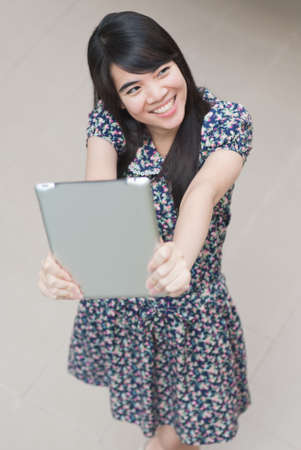 Young Asian woman using a pad PC photo
