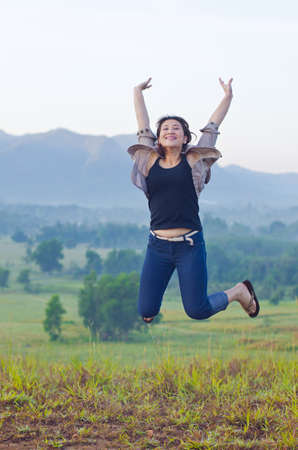 Pretty woman with opened arms expressing freedom photo