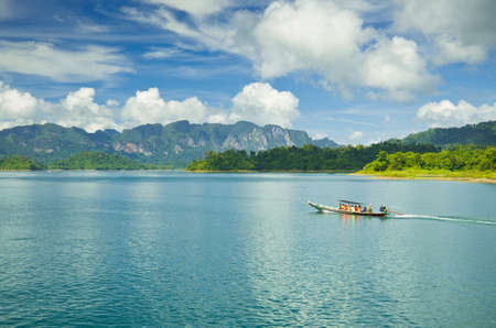 Travel by small boats, Ratchapapha dam area in Surat Thani province, Thailand.