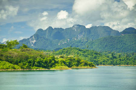 Beautiful mountain surrounded by water, Natural attractions in Ratchapapha dam at Surat Thani province, Guilin of Thailand.