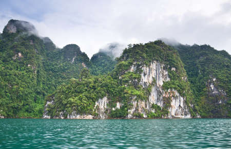 Beautiful mountains and natural attractions in Ratchaprapha Dam at Khao Sok National Park, Surat Thani Province, Thailand. Stock Photo - 21890990