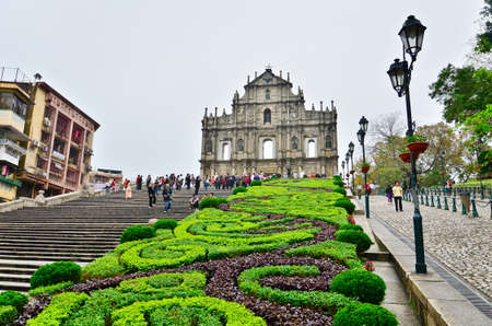 MACAU-MAY 9 : Tourists visit the Historic Centre of ruined church of St Paul on May 9, 2013 in Macau, China. The ruined church of St Paul was inscribed on the UNESCO World Heritage List in 2005. Editorial
