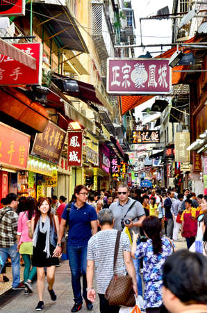 visitors area: MACAU-MAY 9 : Tourists visit the Historic Centre of Macao-Senado Square on May 9, 2013 in Macau, China. The Historic Centre of Macao was inscribed on the UNESCO World Heritage List in 2005.