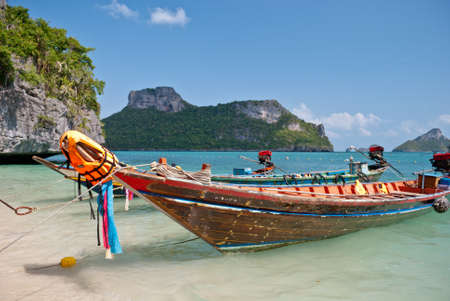 Tropical beach, traditional long tail boats at Angthong national marine park close to Koh Samui photo