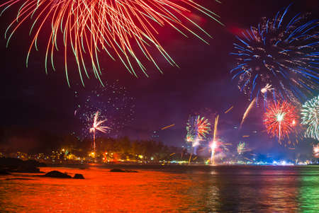 beautiful fireworks celebrating new year on patong beach thailand photo