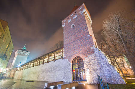 polska: tower of the city fortification in old town at night,krakow,poland Editorial