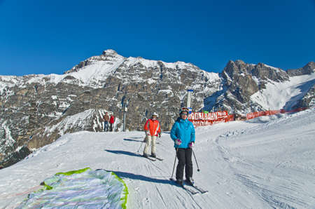 INNSBRUCK, AUSTRIA - MARCH 14: Families enjoy skiing at Alp mountain, Innsbruck, Austria on March 14, 2012. Innsbruck belongs to one of the best winter sports regions of the Alps.