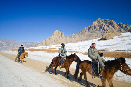 purported: ULAANBAATAR: MONGOLIA - FEB 25: Nomads riding on their faithful horses, Ulaanbaatar on February 25, 2012, The horses breed is purported to be largely unchanged since the time of Genghis Khan