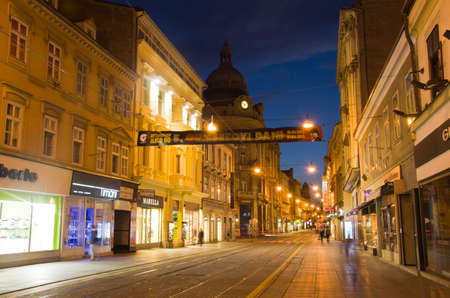 ZAGREB, CROATIA - MARCH 18: People walk at night along Ilica street on March 18, 2012 in Zagreb, Croatia. Ilica is one of the longest and the most expensive residential street in the city.