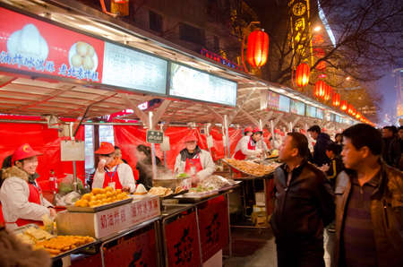 BEIJING-FEB 20: Food vendors at the Donghuamen Night Market near Wangfujing Street on February 20, 2012 in Beijing, China. Wangfujing is a 700-year-old street.