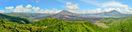 Panoramic view of Batur volcano in the sunshine day photo
