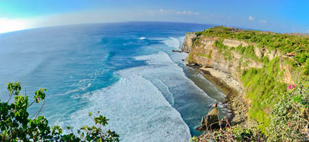 perfect waves: Panorama of Big cliffs with perfect waves on a sunny day at Uluwatu, Bali Indonesia