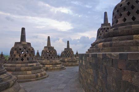 Buddist temple Borobudur on sunset. Yogyakarta. Java, Indonesia photo