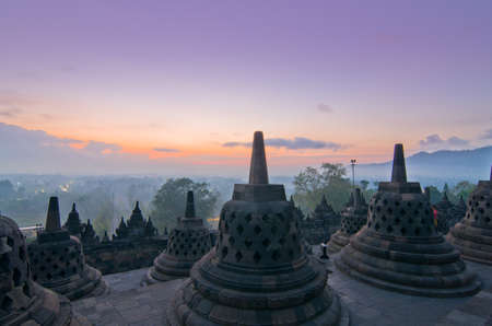 the stupa: Sunrise Borobudur Temple Stupa in Yogyakarta, Java, Indonesia. Stock Photo