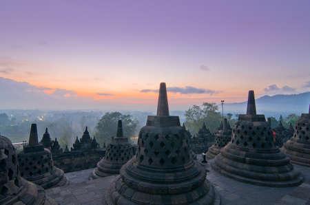 stupas: Sunrise Borobudur Temple Stupa in Yogyakarta, Java, Indonesia. Stock Photo