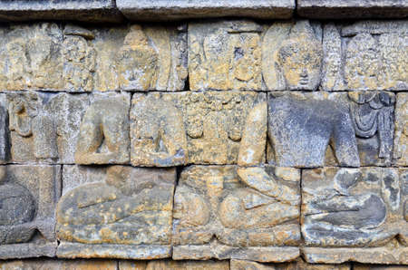 Buddhist bas-relief detail in borobudur temple sit photo