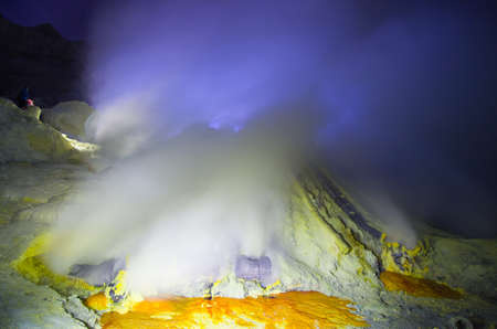 Kawah Ijen volcano, East Java - blue sulfur flames.