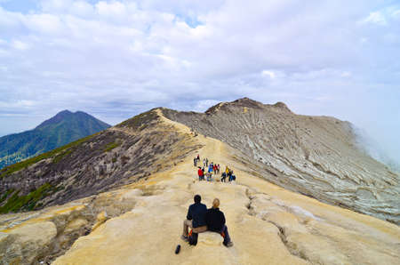 Extracting sulphur inside Kawah Ijen crater, Indonesia Stock Photo