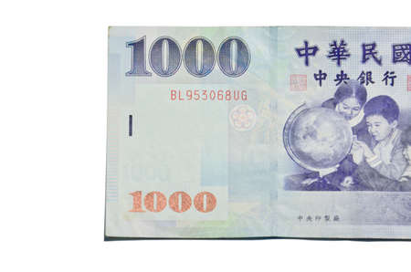 thousands: A 1000 New Taiwan Dollars bill on white background Stock Photo