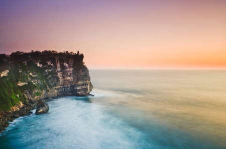 Sunset from the Pura Uluwatu temple on Bali island in Indonesia photo