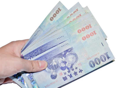 nt: A hand holding a 1000 New Taiwan Dollar bill.
