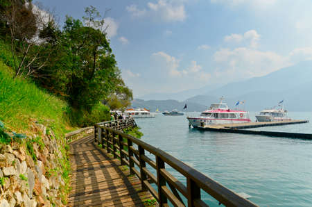 ridgeline: SUN MOON LAKE - OCT 25: many boats parking at the pier on October 25, 2013 at Sun Moon Lake, Taiwan. Sun Moon Lake is the largest body of water in Taiwan as well as a tourist attraction.