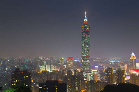 a beautiful Evening of Taipei city and Taipei 101 with silhouette of a mountain in front