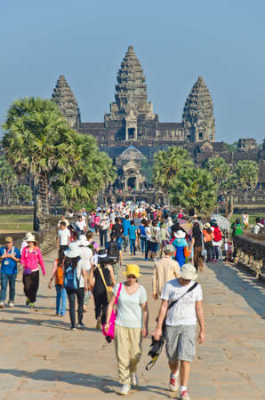 milion: ANGKOR WAT - JAN ,4 : tourists at temple Angkor Wat on Jan 4,2014 in Siem Reap,Cambodia.Templ es of Angkor are the most famous attraction in Cambodia with more than 2 milion visitors per year.