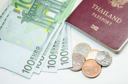 schein: passport with bank notes Stock Photo