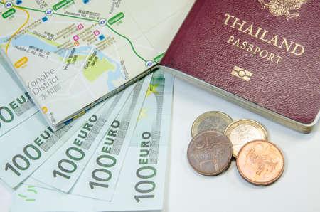 schein: passport with bank notes Stock Photo