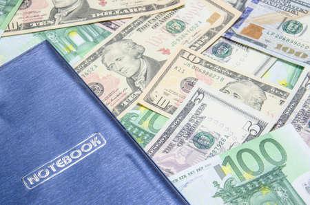notepad on dollars background photo
