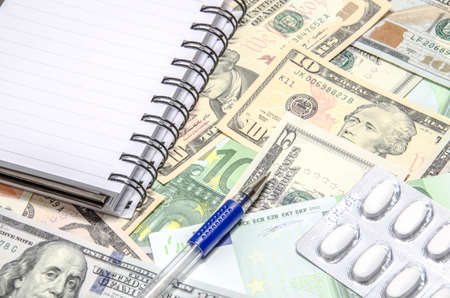notebook on American USD and euros banknotes background. Space for copy inside. photo